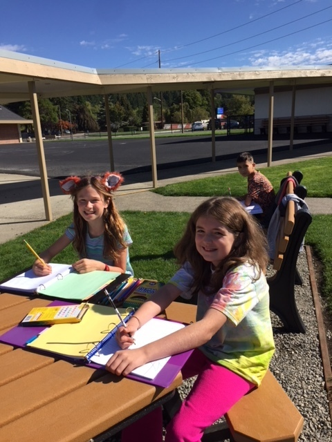 Students enjoy new benches outside district office!