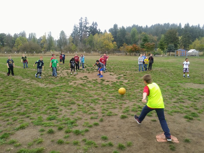 Students enjoy kickball after school.