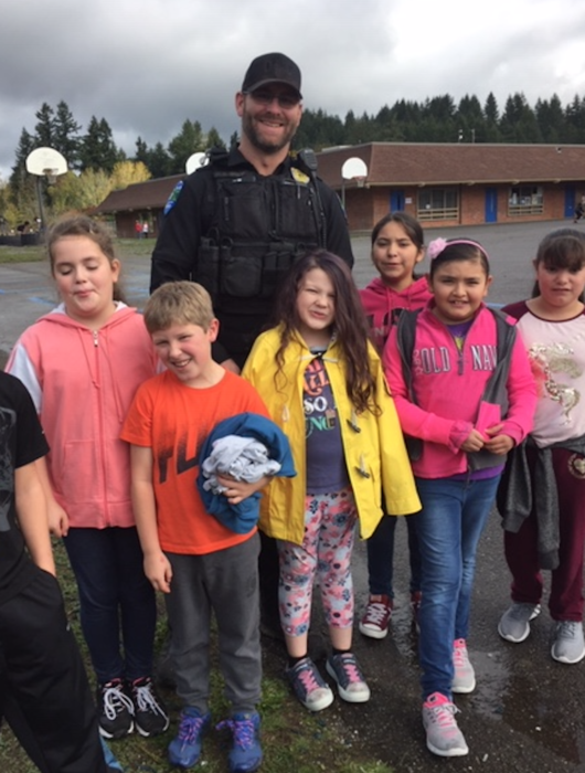 Students hang out with our school resource officer.