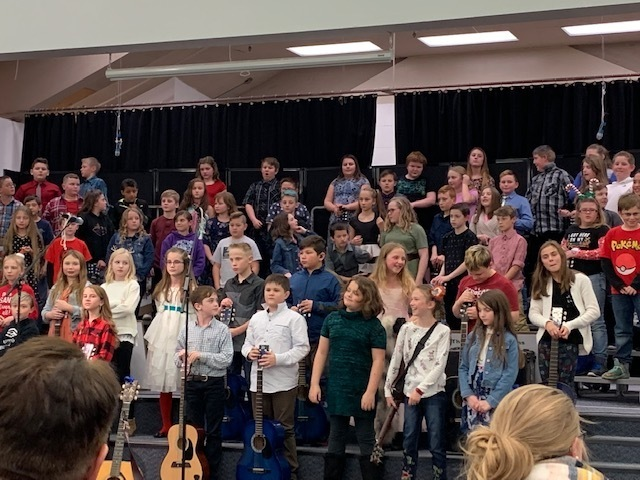 5th Graders performing at the guitar concert.