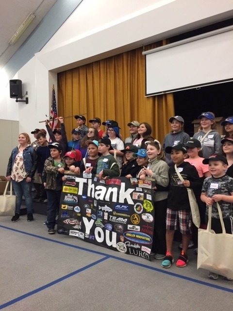 Students with thank you banner at Fishing Clinic.