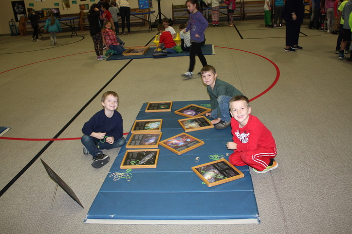 Students exploring exhibits from Pacific Science Center at Parkside!