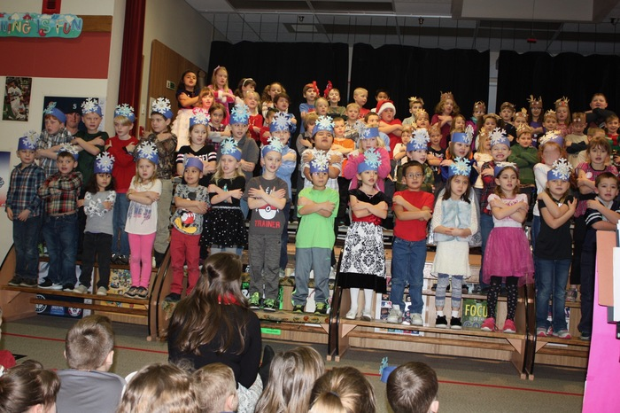 Students Singing during the Winter Sharing Program in December. 1st Grade