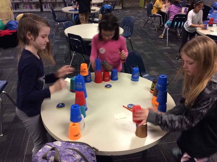 Students practice triple stack.