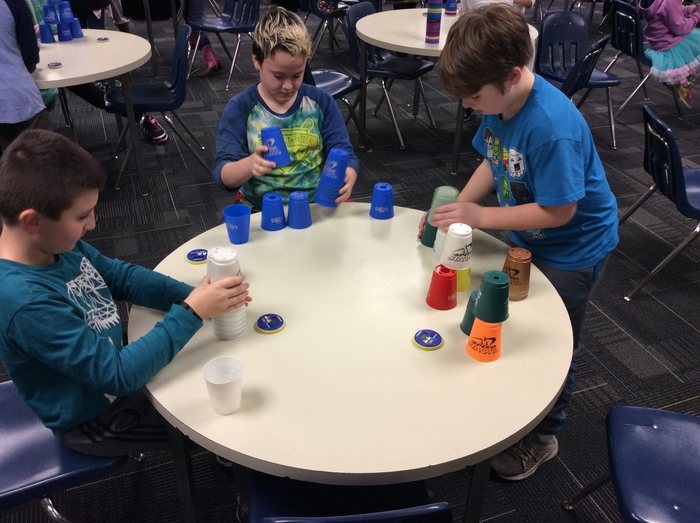 Children stacking cups