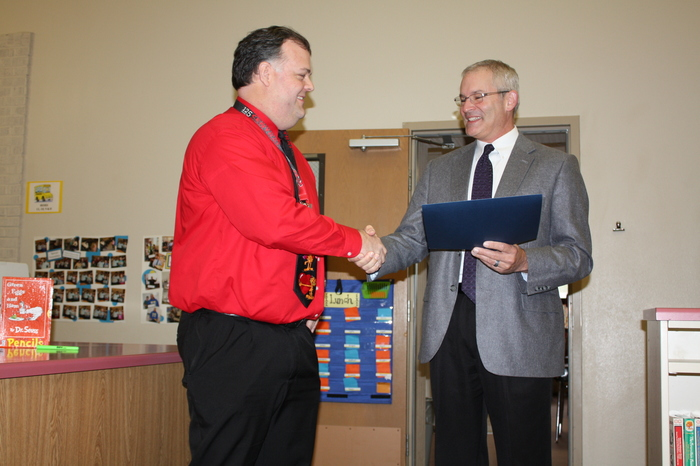 Mr. Williams receiving ESD 113 Capital Region Principal of the Year Award from AWSP's Ron Sisson.