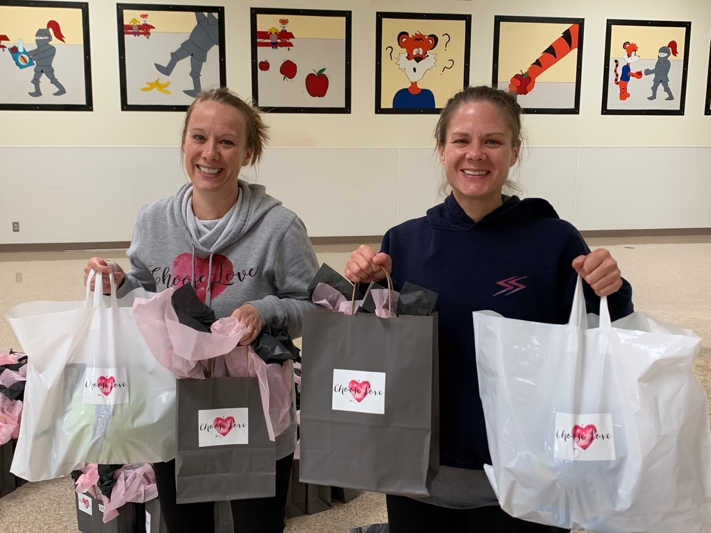 Sisters with gift bags
